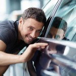 man checking side of car - we also offer other services