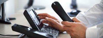man dialing phone - order a car